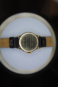 9ct gold Smiths de luxe manual wrist watch on a brown leather strap back
