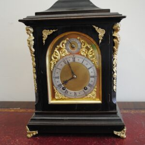 8 day 'Ting Tang' striking bracket clock by Wintermeier & Hoffmeier Ebonized wooden case with gilt brass spandrels on door front