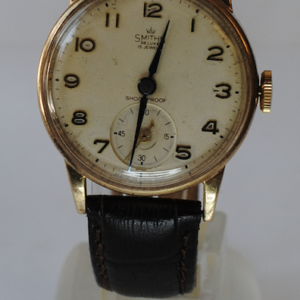 9ct gold Smiths de luxe manual wrist watch on a brown leather strap