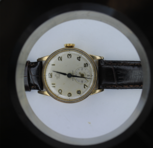 9ct gold Smiths de luxe manual wrist watch on a brown leather strap close
