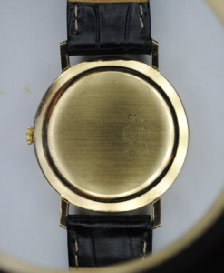 Onsa 14ct gold manual wrist watch with black leather strap back