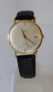 Onsa 14ct gold manual wrist watch with black leather strap close